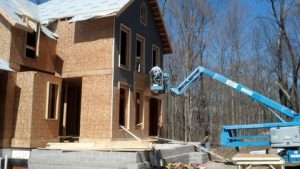 Machinery hovers near a new building in Chagrin Falls.